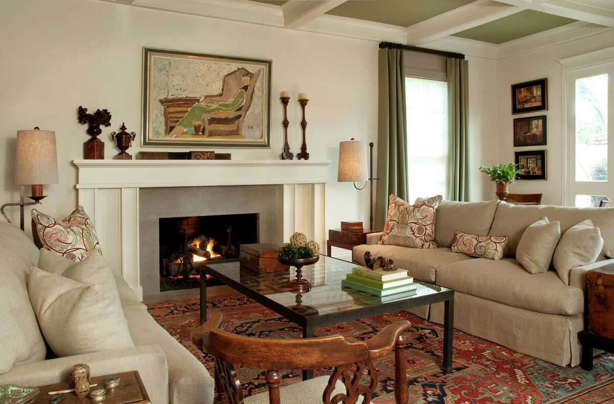 In the living room, Sandy Lucas brought in a large-scale fireplace mantel to match the scale of the space, topped with antique French carved-walnut candlesticks found at Round Top, an 18th-century carved urn found at the Theta Charity Antiques Show and several antique glove boxes.