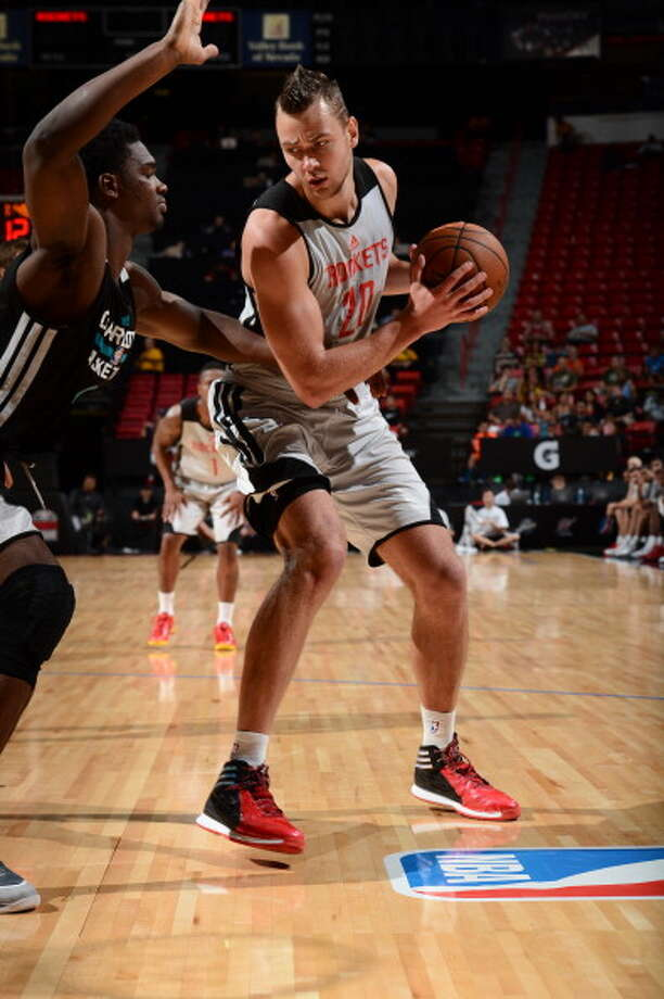 July 20: Rockets 83, Hornets 79Donatas Motiejunas drives during the tournament semifinal game. Photo: Garrett Ellwood, NBAE/Getty Images / 2014 NBAE