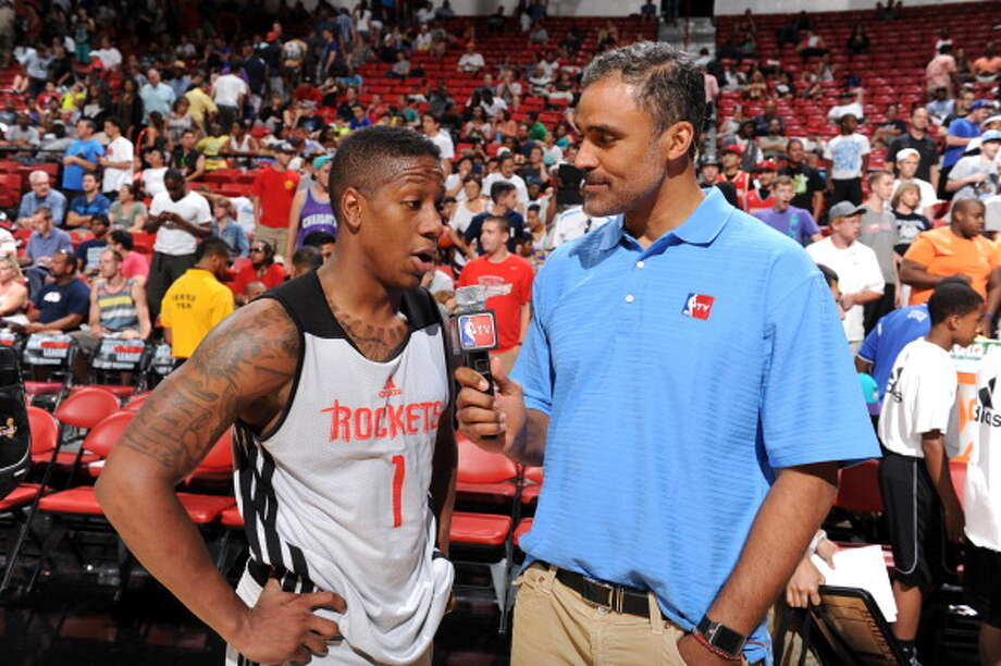 Rick Fox interviews Isaiah Canaan after the game. Photo: Garrett Ellwood, NBAE/Getty Images / 2014 NBAE
