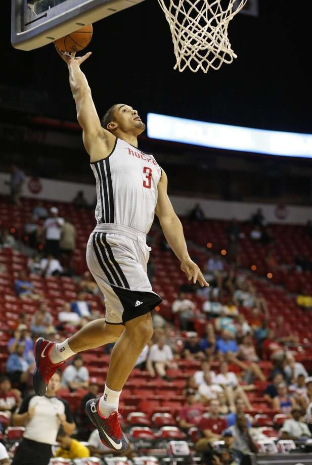 Nick Johnson goes up for a shotNick Johnson goes up for a shot. Photo: John Locher, Associated Press