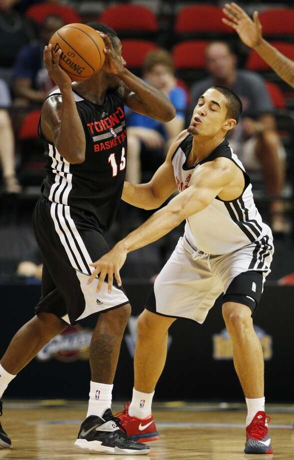 Nick Johnson tries to steal the ball from Dwight Buycks. Photo: John Locher, Associated Press