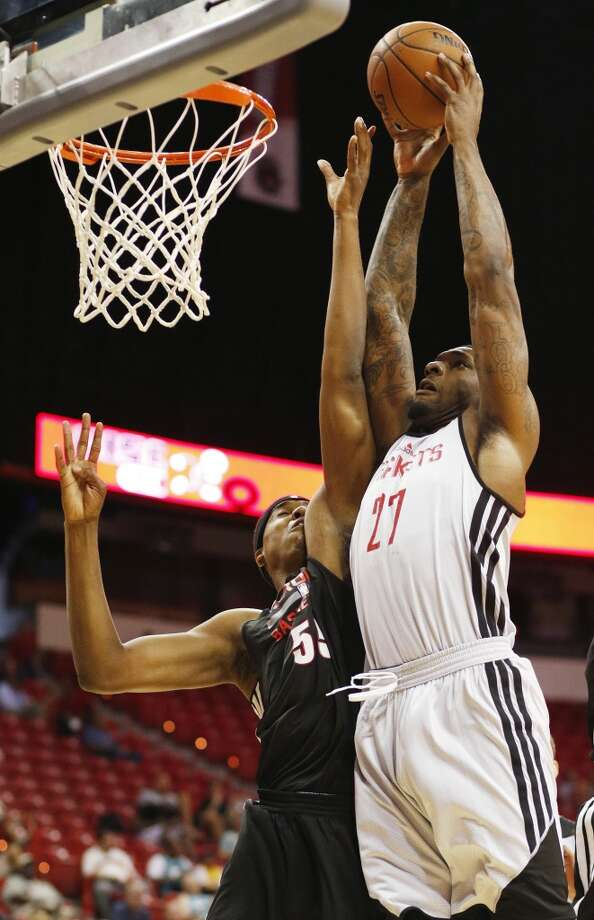 Tarik Black dunks over Hassan Whiteside. Photo: John Locher, Associated Press