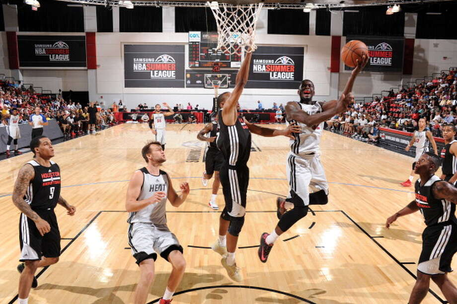 July 12: Heat 92, Rockets 81  Miami's James Ennis drives to the basket. Photo: Garrett Ellwood, NBAE/Getty Images / 2014 NBAE