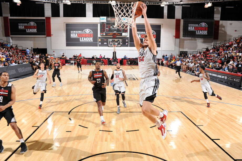 Miami's Danilo Barthel goes up for a dunk. Photo: Garrett Ellwood, NBAE/Getty Images / 2014 NBAE