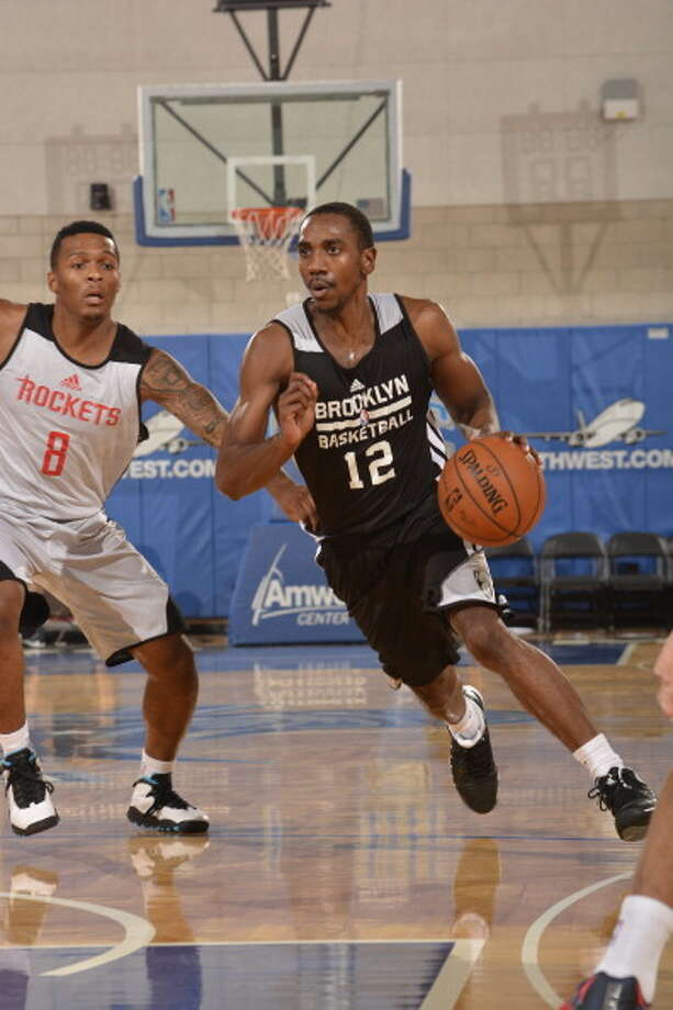 ORLANDO, FL - JULY 11: Marquis Teague #12 of the Brooklyn Nets drives to the basket against the Houston Rockets during the game during the Samsung NBA Summer League 2014 on July 11, 2014 at Amway Center in Orlando, Florida. NOTE TO USER: User expressly acknowledges and agrees that, by downloading and or using this photograph, User is consenting to the terms and conditions of the Getty Images License Agreement. Mandatory Copyright Notice: Copyright 2014 NBAE  (Photo by Fernando Medina/NBAE via Getty Images) Photo: Fernando Medina, NBAE/Getty Images / 2014 NBAE