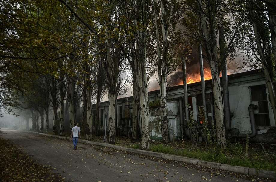 Smoke and flames rise from an old factory in the rebel stronghold of Donetsk after intense 