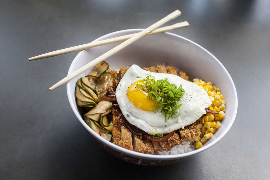 Katsudon, as served at Hay Merchant: A traditional Japanese dish consisting of a crispy pork cutlet, miso corn, pickled cucumber, eggs and rice. Photo: Julie Soefer