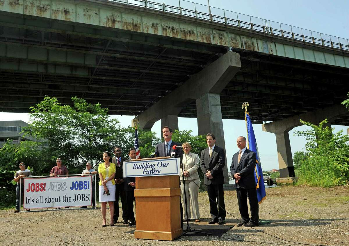 U.S. Rep. Jim Himes holds a press conference in the foreground of the Yankee Doodle Bridge in Norwalk, Conn. on Monday, July 21, 2014. Himes said Congress must move beyond short term fixes to find revenue for trillions of transportation repairs and upgrades nationwide. The bridge is one of the state's most structurally deficient bridges, the fourth worst bridge in Connecticut.