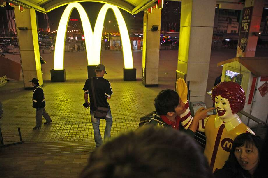McDonald's says it is suspending the distribution and sale of products from a supplier in China that allegedly sold expired meat to fast-food restaurants. Photo: Ng Han Guan, Associated Press