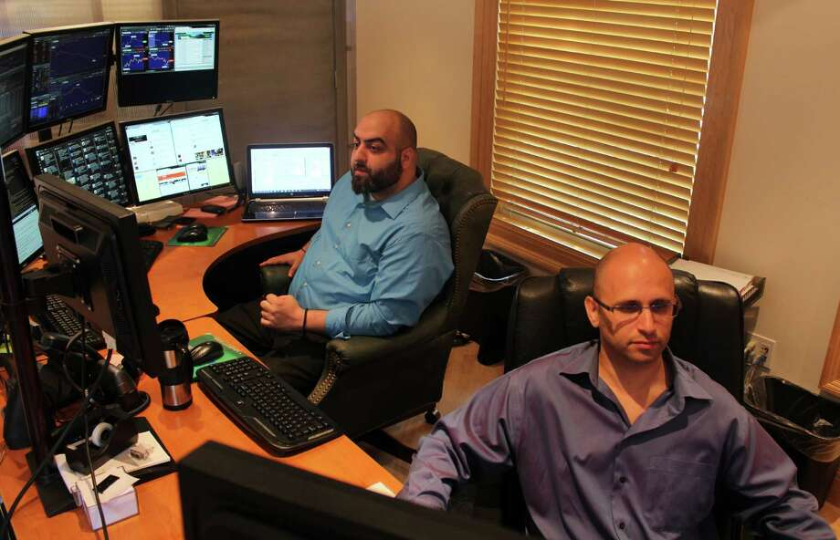 Milton Marmanides, left, and George Avidon have launched TradeXchange, which provides news to traders in the financial markets through a proprietary website. Photo: Westport News/Contributed Photo / Westport News