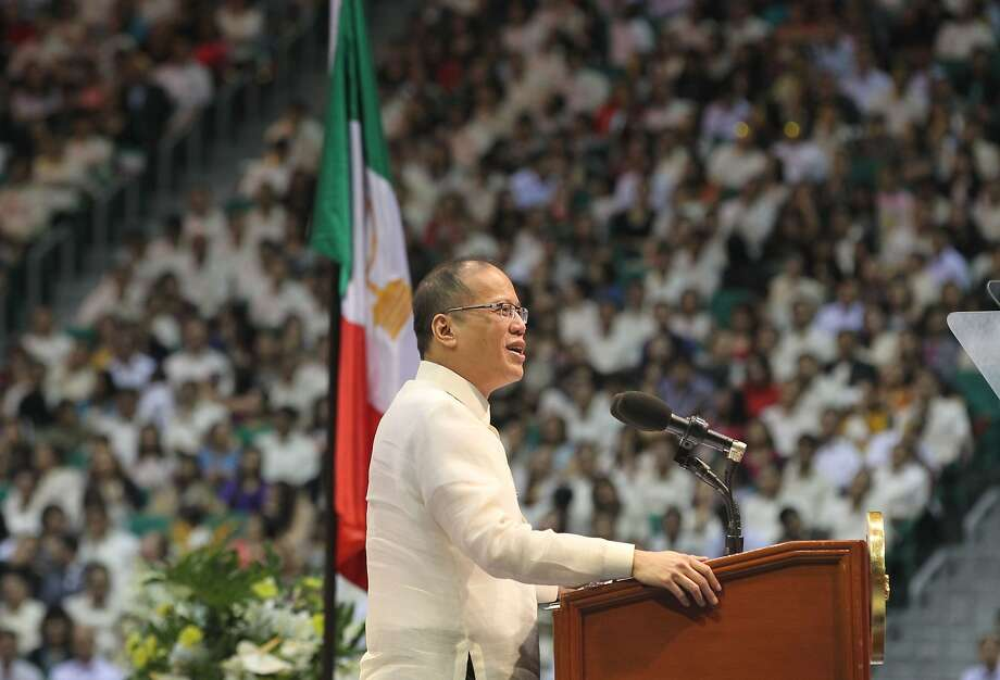 President Benigno Aquino III speaks at the opening ceremony of the world's largest indoor stadium, built by a religious sect in Bocaue, Philippines. Photo: Ryan Lim, AFP/Getty Images