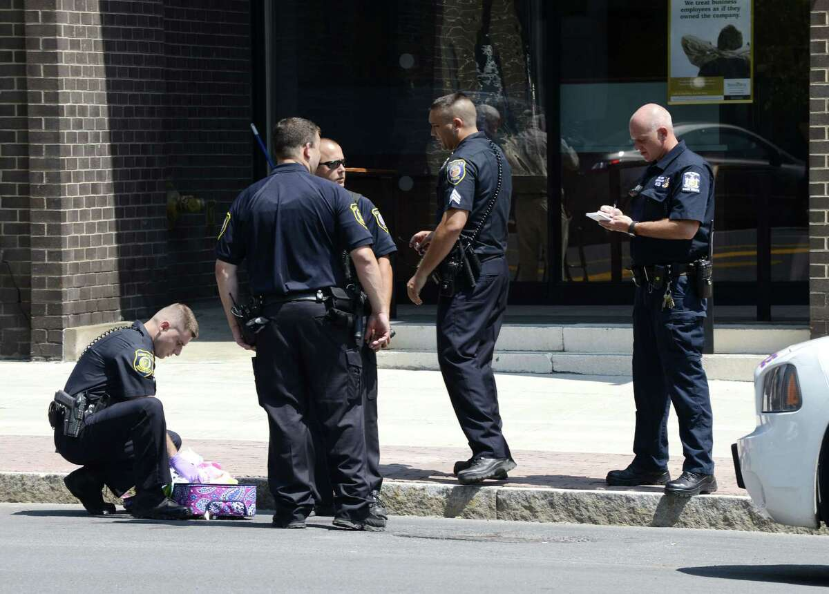Albany police investigate a suspicious package found outside 41 State St. after the package was deemed safe Monday morning, July 21, 2014, in Albany, N.Y. A bomb squad experts, that included members of the FBI, were called to the scene and x-rayed the package to determine there was nothing nefarious inside. briefly stopped traffic in the vicinity of James Street. (Will Waldron/Times Union)