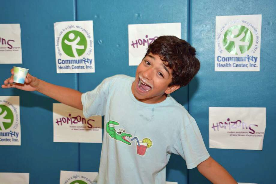 Eighth-grader grader Solomon Zapata, of Norwalk, enjoys a lighthearted moment at the recent health fair. Photo: Contributed Photo, Contributed / New Canaan News Contributed