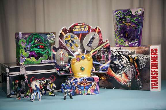 "This Friday, July 18, 2014 photo shows exclusive, collectible toys available from Hasbro at 2014 Comic-Con, in San Diego. Marvel's ""The Thanos Imperitive"" action figure set, at center with a foam Infinity Gauntlet, is seen with, from left, the Transformers ""Knights of Unicron"" collection, My Little Pony Mane-iac Mayhem figure, Transformers Dinobots collection and My Little Pony Equestria Girls figure. Several toy makers and publishers are offering collectible toys and books  at the annual pop-culture celebration, which kicks off Thursday, July 24, 2014, in San Diego. (AP Photo/Nick Ut)"