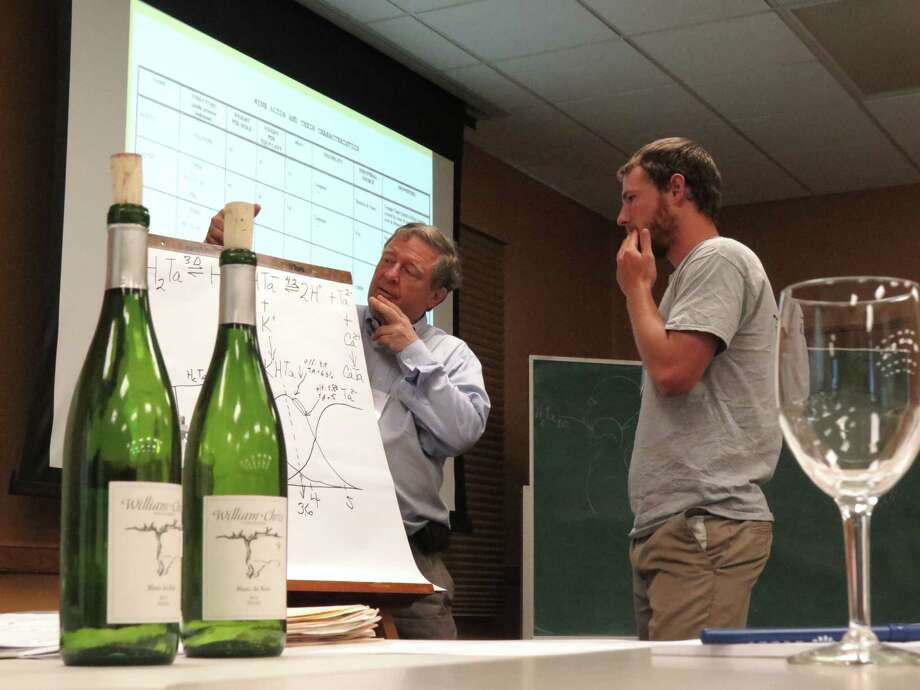 "Master sommelier Clark Smith, left, offers advice to Doug Lewis of Lewis Wines during a Texas Hill Country Wineries Association two-day seminar called ""Fundamentals of Modern Wine Chemistry"" in Fredericksburg, Texas, on Tuesday, July 15, 2014. Photo: Billy Calzada, San Antonio Express-News /  San Antonio Express-News"