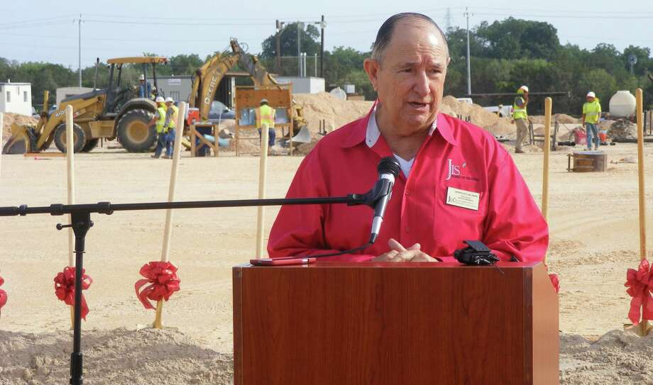 Judson ISD School Board President Arnold Salinas heralds the state-of-the- art high school expected to open August 2016 during the ground- breaking for the school on July 15. Photo: Jeff B. Flinn / Northeast Herald