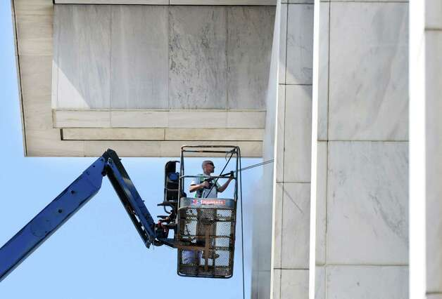 Pat Malatesta of Niskayuna, with DeBrino Caulking Associates of Castleton, power washes the Legislative Office Building's exterior walls Monday morning, July 21, 2014, at the Empire State Plaza in Albany, N.Y. The building last underwent a total cleaning and recaulking back in the early 1990s. (Will Waldron/Times Union) Photo: WW