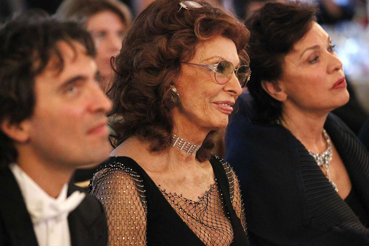 From left, Carlo Ponti, Sophia Loren, and Maria Manetti Shrem listen to tributes to Loren at dinner during the annual Festival del Sole, featuring