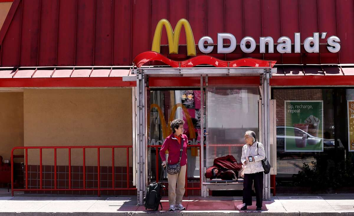 The bus stop in front of the McDonald's fast food restaurant on the corner of 3rd and Townsend Streets as seen on Saturday July 19, 2014, in San Francisco, Calif. A developer has purchased the property that the McDonald's now occupies, which is a big hang out for Giants fans on game day, but it may be torn down to make way for a hotel.