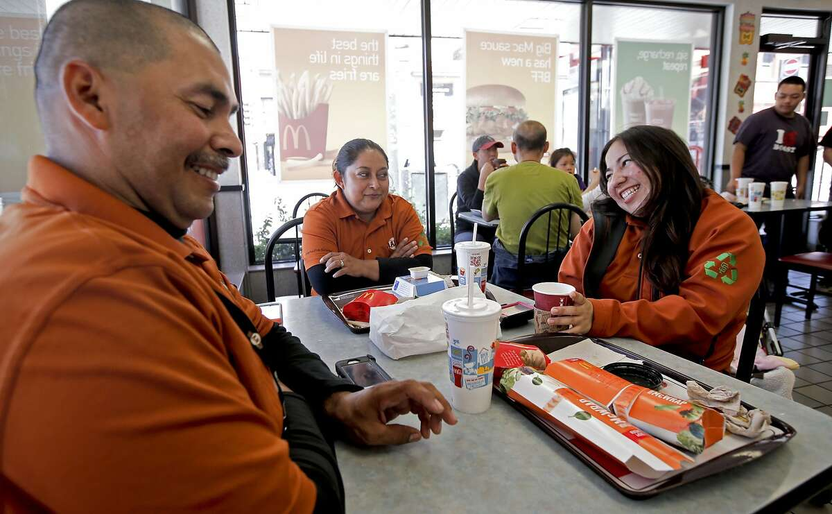 San Francisco Giants' employees, (l to r) Henry Martinez, Maria Perez and Karla Lorencillo said that they always eat at McDonald's on the corner of 3rd and Townsend streets before starting their shifts at AT&T Park as seen on Saturday July 19, 2014, in San Francisco, Calif. A developer has purchased the property that the McDonald's now occupies, which is a big hang out for Giants fans on game day, but it may be torn down to make way for a hotel.