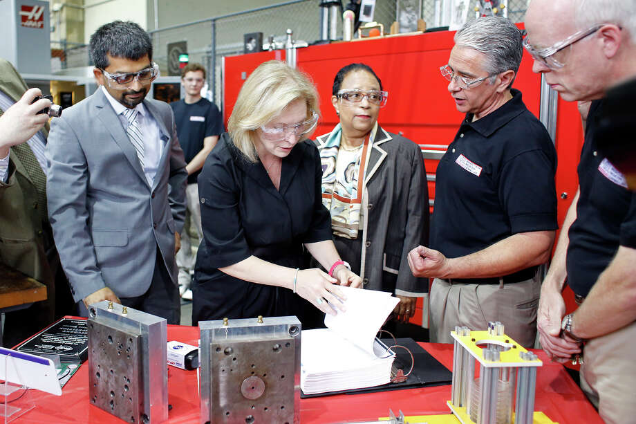 Senator Kirsten Gillibrand learns about how Rensselaer Polytechnic Institute is a leader in the creation of jobs based on state funded research for innovative technologies Monday, July 21, 2014, during a media event at the Low Center for Industrial Innovatio in Troy, N.Y.  Gillibrand is backing a bill called the Technology and Research Accelerating National Security and Future Economic Resiliency, or TRANSFER Act, which could work in concert with Start-Up NY in attracting more venture capital. (Tom Brenner/ Special to the Times Union) Photo: Tom Brenner / ©Tom Brenner/ Albany Times Union