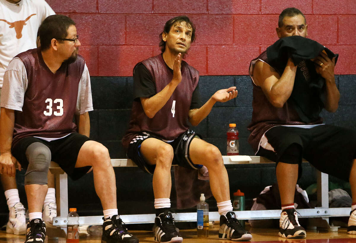 Harlandale alumnus and actor Jesse Borrego (center) with the 80's team during the 2014 Harlandale Alumni Basketball Tourney at Harlandale Middle School July 13. The three day tournament featured 15 men's teams and 5 women's teams.