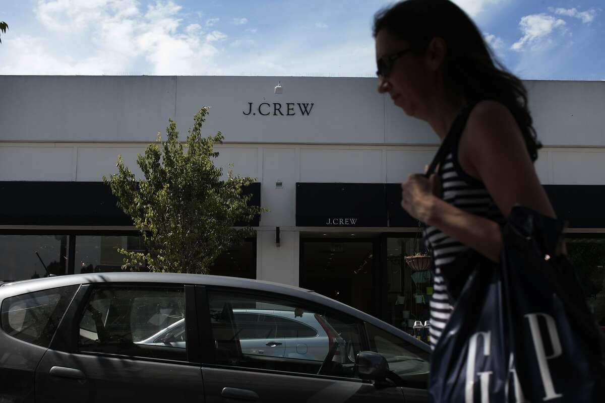 A woman passes the J. Crew on Burlingame Ave. on Saturday, July 19, 2014 in Burlingame, Calif. J Crew's new 000 size has caused a stir regarding vanity sizing.