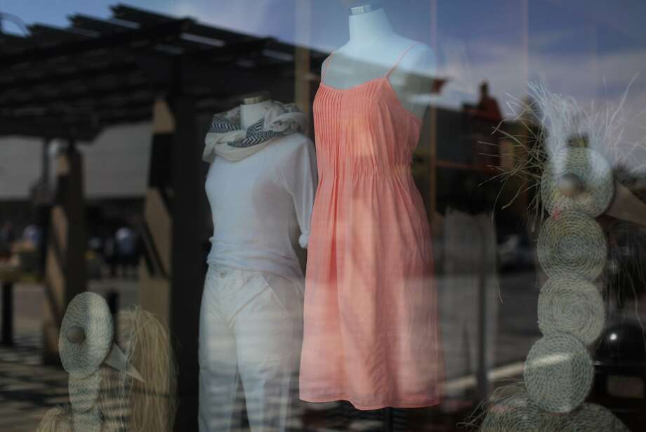 Women's apparel is on display Saturday at the J.Crew in Burlingame. The company, which recently added size 000 pants, says its sizes run large. Photo: James Tensuan, The Chronicle