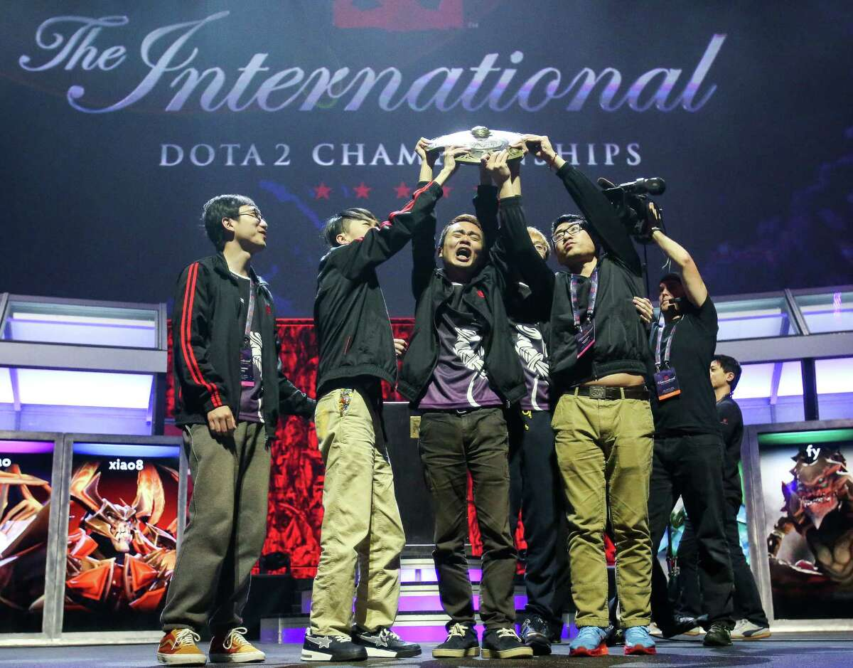 Team NewBee hoists the Aegis of Champions trophy after winning The International DOTA 2 Championships. Thousands packed KeyArena to watch The International DOTA 2 Championships on Monday, July 21, 2014. The Chinese team NewBee took home the Aegis of Champions after beating Vici Gaming in three out of four games.
