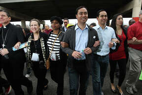 """METRO -- From left, Archbishop Gustavo Garcia-Siller, Aaronetta Hamilton Pierce, District 2 Councilwoman Ivy Taylor, Texas State Rep. Joaquin Castro, Mayor Julian Castro and his wife, Erica, participate in the City of San Antonio Martin Luther King, Jr., 25th anniversary Commemorative March, Monday, Jan. 16, 2012. This year's theme was """"Journey Beyond the March...Live Beyond the Dream"""". JERRY LARA/glara@express-news.net"""