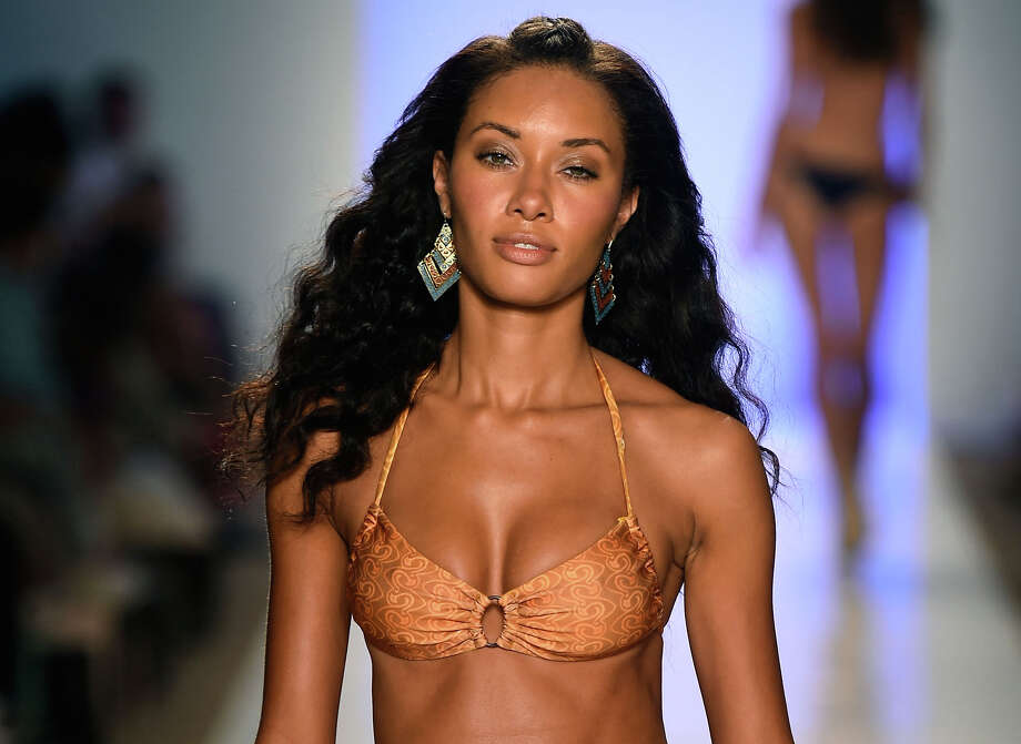 A model walks the runway at the Sauvage/Aguaclara Swimwear/Aquarella Swimwear/Mia Marcelle/Toxic Sadie Swimwear fashion show during Mercedes-Benz Fashion Week Swim 2015 at Cabana Grande at The Raleigh on July 21, 2014 in Miami, Florida.  Photo: Frazer Harrison, (Credit Too Long, See Caption) / 2014 Getty Images