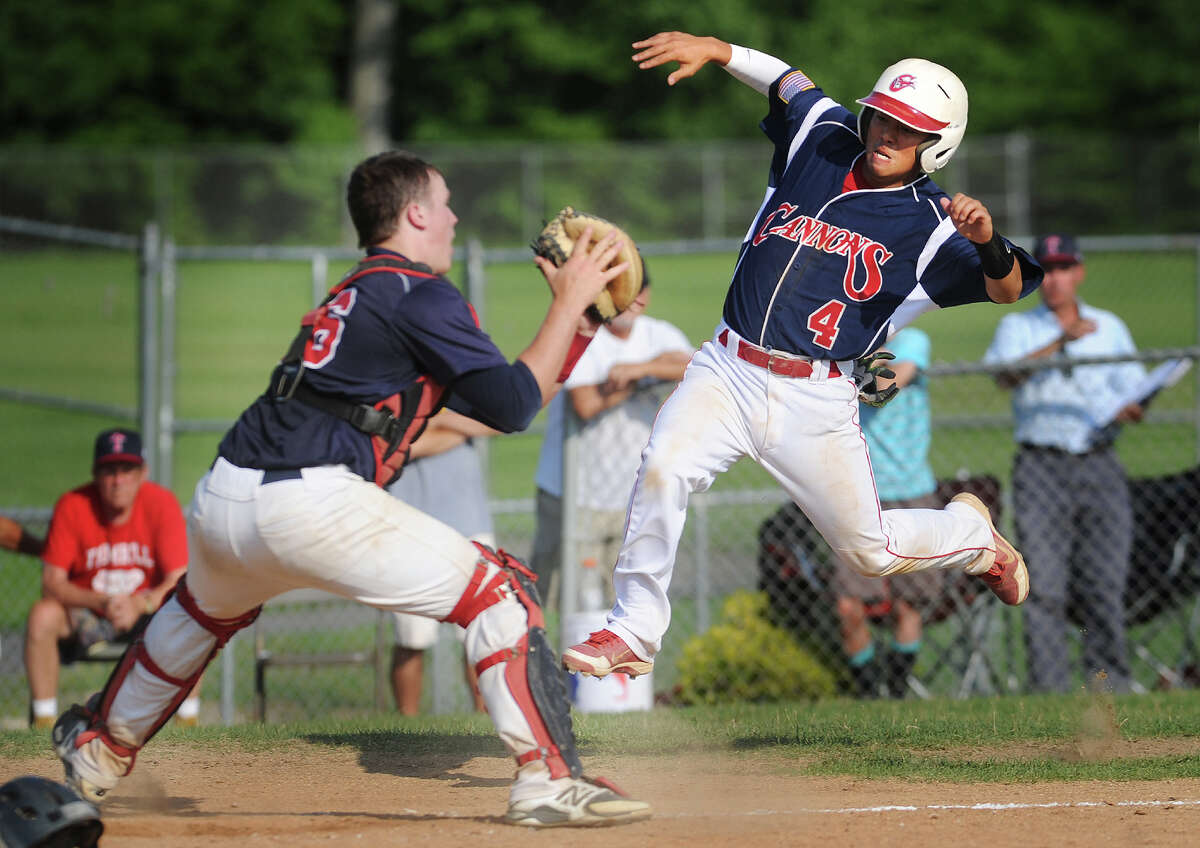 Trumbull Post 141 catcher Zach Sagar, left, prepares for a home plate collision as Greenwich's Ricky Okazaki attempts to score from first on a dropped fly ball in the 6th inning of Trumbull's 2-1 American Legion baseball victory at Trumbull High School in Trumbull, Conn. on Monday, July 21, 2014. Okazaki was tagged out on the play.