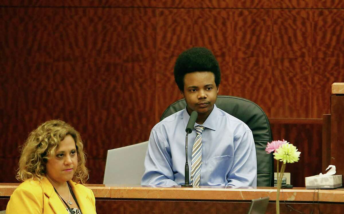 Harlem Lewis testifies in during his capital murder trial, Lewis is accused of fatally shooting Bellaire Police Corporal Jimmie Norman and Terry Taylor on December 24th 2012, in Judge Mark Ellis' 351st State District Court Friday, July 18, 2014, in Houston. ( James Nielsen / Houston Chronicle )
