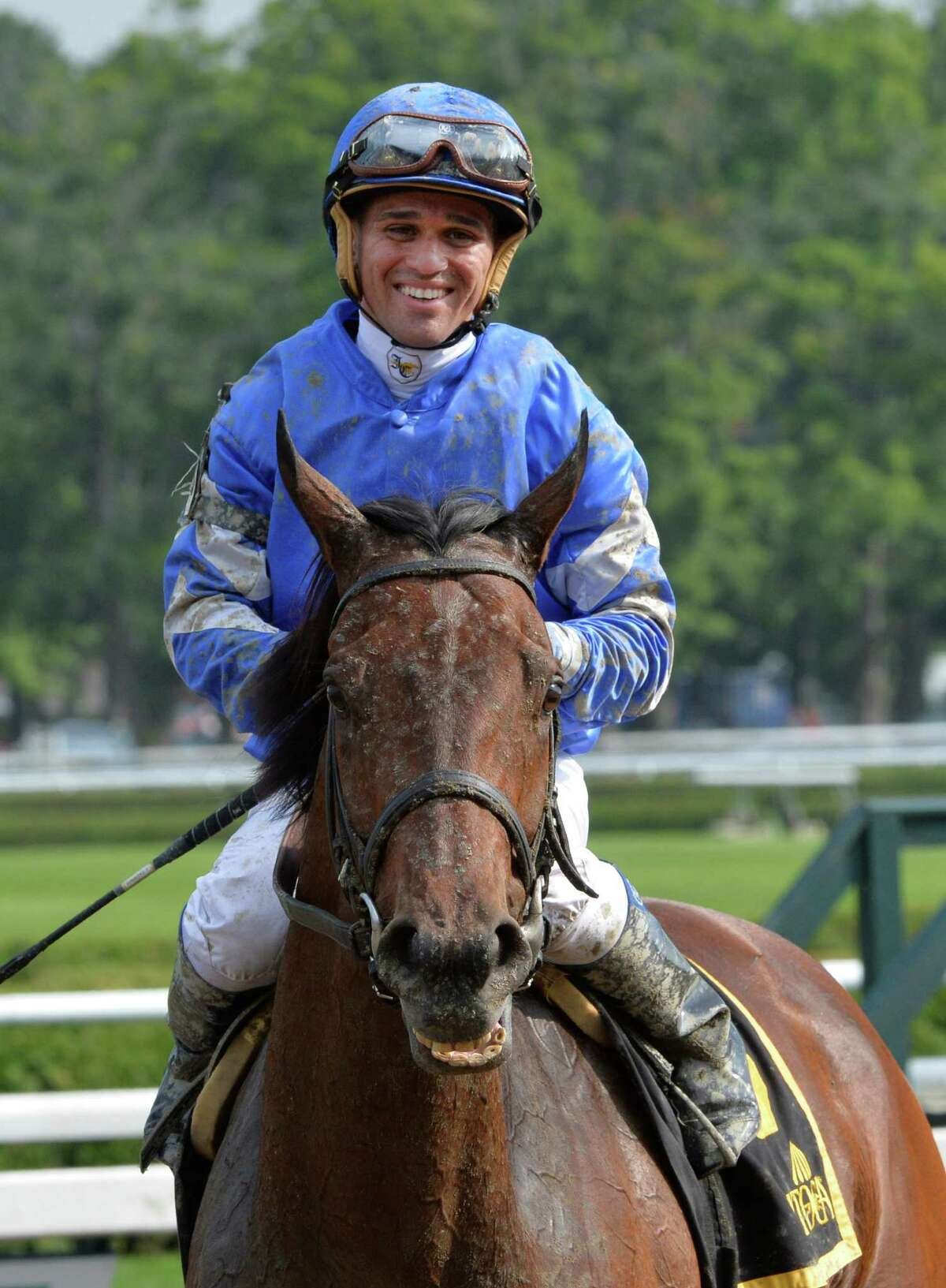 Jockey Javier Castellano is all smiles as he sits atop Better Lucky after winning the Shine On Stakes Monday afternoon July 21, 2014 at the Saratoga Race Course in Saratoga Springs, N.Y. (Skip Dickstein / Times Union)