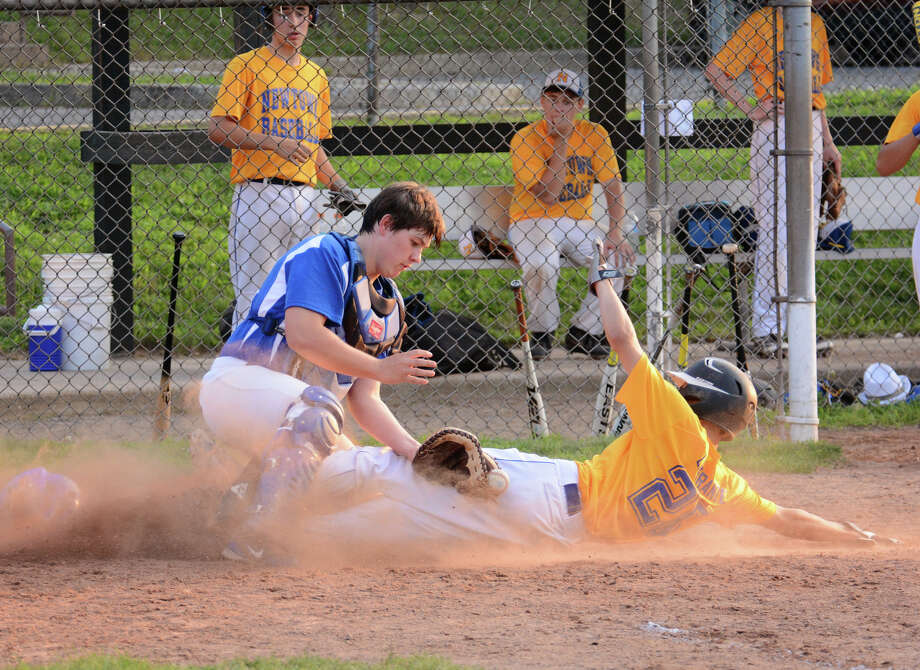 Darien's catcher Cord Fox (42) attempts an out as Newtown's Michael Liberante (26) slides home during the 15U Babe Ruth baseball game at Holahan Field in Darien on Monday, July 21, 2014. Photo: Amy Mortensen / Connecticut Post Freelance