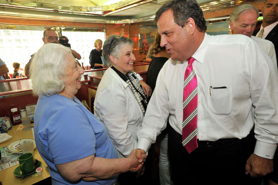New Jersey Governor Chris Christie greets Greenwich Republican Town Committee member Louise Bavis, with fellow RTC member Kathy Derene in the middle looking on, while stumping for Tom Foley, Republican gubernatorial candidate, at the Glory Days Diner in Greenwich, Conn., on Monday, July 21, 2014. Photo: Jason Rearick / Stamford Advocate