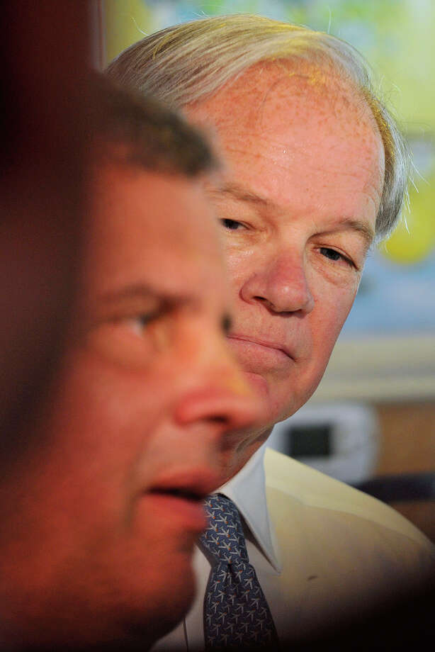 Republican gubernatorial candidate Tom Foley, left, looks on as New Jersey Governor Chris Christie takes questions from the media at the Glory Days Diner in Greenwich, Conn., on Monday, July 21, 2014. Photo: Jason Rearick / Stamford Advocate