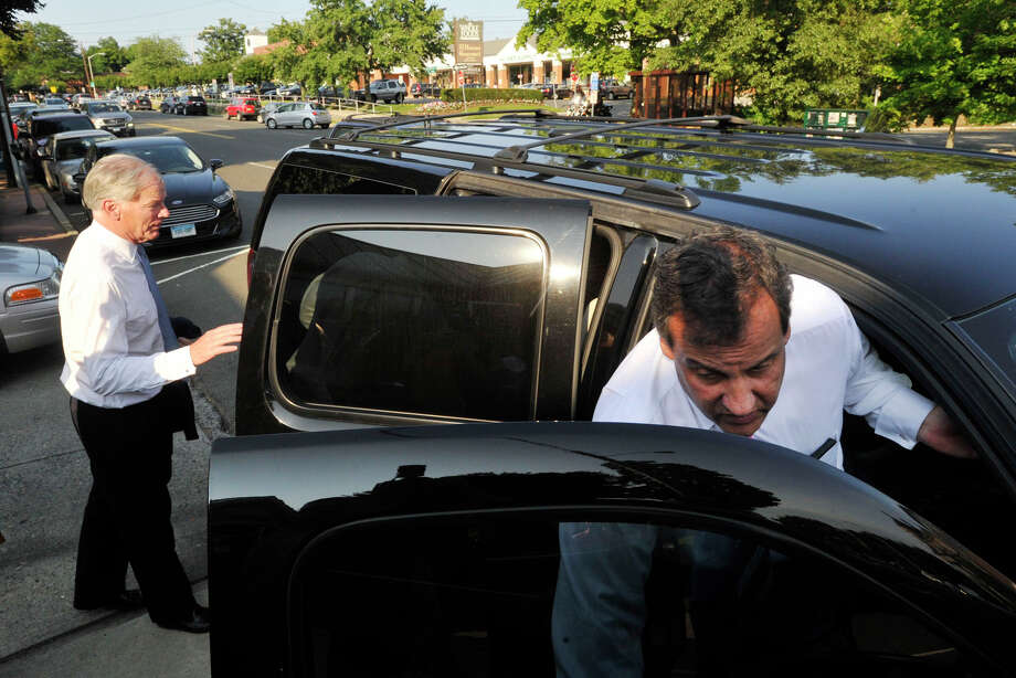 Republican gubernatorial candidate Tom Foley, left, and New Jersey Governor Chris Christie leave the Glory Days Diner in Greenwich, Conn., after Christie stumped for Foley on Monday, July 21, 2014. Photo: Jason Rearick / Stamford Advocate