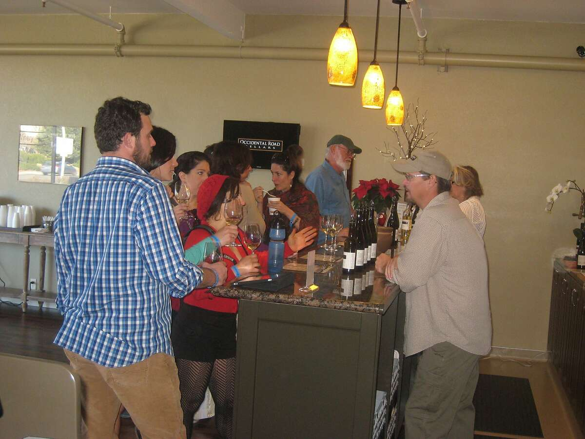 Guests at the Occidental Road Cellars may receive a sample of the winery's offerings from owner Richard Prather (in baseball hat) in one of the welcoming tasting rooms.