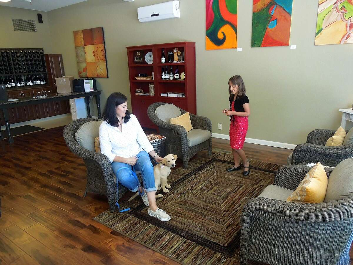Occidental Road Cellars owner Joelle Prather with her daughter Fiona Prather and their puppy, Dash.