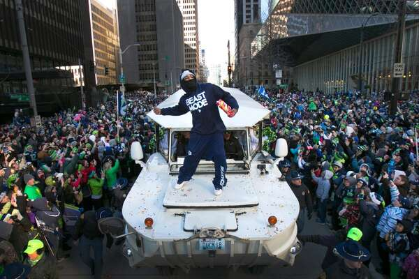 2014: 700,000 brave cold to celebrate Super Bowl win Despite temperatures in the 20s, more than 700,000 fans flocked to downtown Seattle for the Seahawks' Super Bowl victory parade Feb. 5, 2014. Members of the world-champion Hawks whooped it up with the crowd as their parade vehicles crept through downtown -- including Marshawn Lynch, who threw Skittles, took pulls of Fireball whiskey and banged on an Indian-American drum. The parade ended at CenturyLink Field, where thousands more fans were waiting to watch the Seahawks' trophy ceremony.