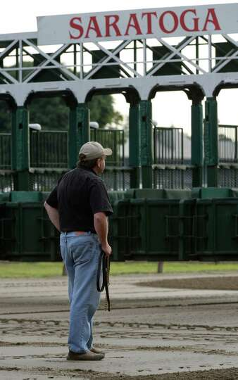 Trainer Jim Bond waits for his Jim Dandy entrant Legend to approach the gate Monday morning, July 21