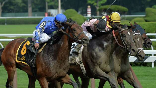 #6 Better Lucky with jockey Javier Castellano rushes up on the outside of the rest of the competitors to win the Shine On Stakes Monday afternoon July 21, 2014 at the Saratoga Race Course in Saratoga Springs, N.Y.         (Skip Dickstein / Times Union) Photo: SKIP DICKSTEIN