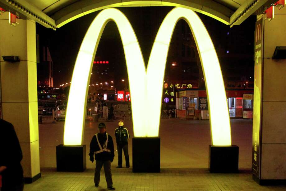 In this photo taken Saturday, May 21, 2011, a giant logo of fast food restaurant McDonald's is displayed at a train station in Shenyang in northern China's Liaoning province.  McDonald's and KFC in China faced a new food safety scare Monday, July 21, 2014 after a Shanghai television station reported a supplier sold them expired beef and chicken. (AP Photo/Ng Han Guan) Photo: Ng Han Guan, STF / AP