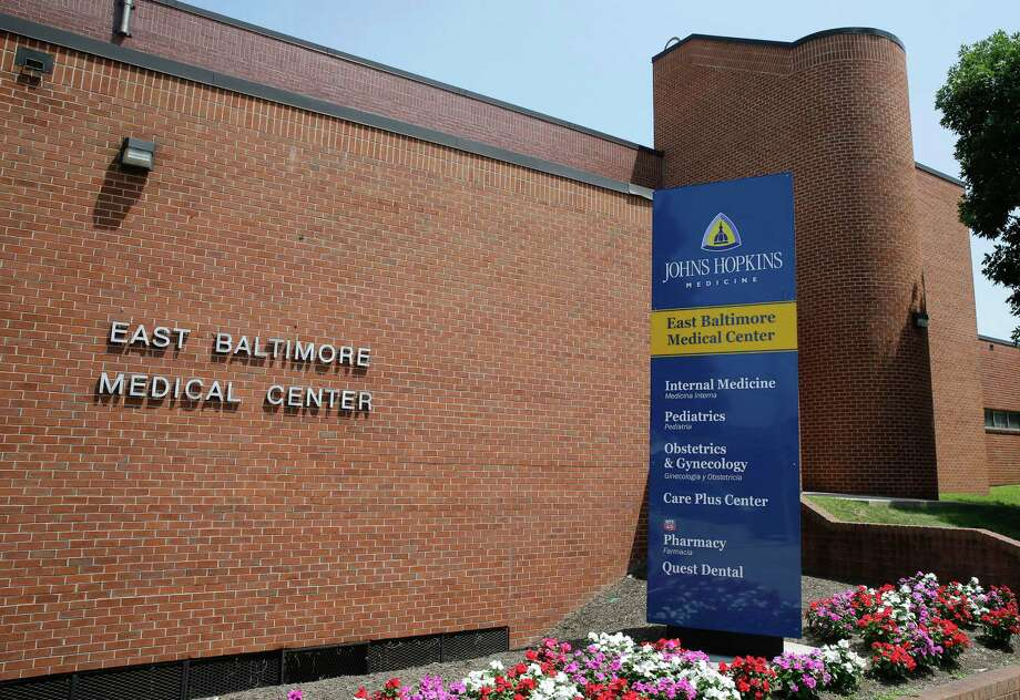 This photo taken July 8, 2014, shows the East Baltimore Medical Center, a community practice affiliated with Johns Hopkins Hospital, in Baltimore. Johns Hopkins Hospital has agreed to a $190 million settlement with more than 8,000 patients of Dr. Nikita Levy, a gynecologist who secretly photographed and videotaped women's bodies in the examining room with a pen-like camera he wore around his neck, lawyers said Monday, July 21, 2014. Levy was working at the East Baltimore Medical Center when the allegations came to light. (AP Photo) Photo: STF / AP
