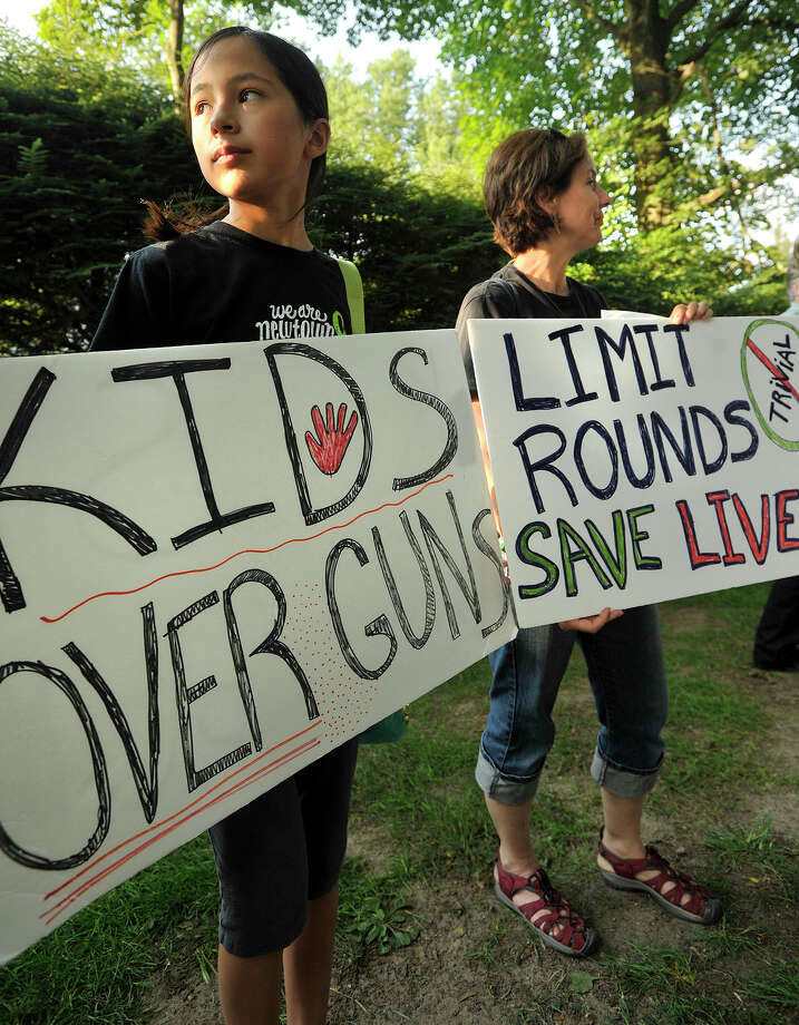 Laura Wong, left, and her mother, Fran Wong, protest along Shore Road in Greenwich, Conn., on Monday, July 21, 2014. The activists were protesting New Jersey Governor Chris Christie's choice to veto a bill in New Jersey that would have limited the number of bullets allowed in a gun magazine. Christie was in Greenwich stumping for Republican gubernatorial candidate Tom Foley. Photo: Jason Rearick / Stamford Advocate