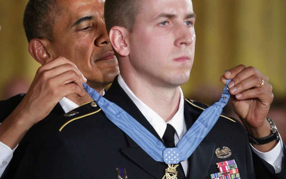 The president presents the Medal of Honor to Ryan Pitts, who kept fighting insurgents after he was badly injured by a grenade. Photo: Alex Wong / Getty Images / 2014 Getty Images