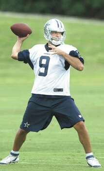 File- This June 18, 2014, file photo shows Dallas Cowboys quarterback Tony Romo passing during an NFL football minicamp, in Irving, Texas. Romo probably wonít have to sneak into competitive situations when the Dallas Cowboys hold their first training camp practice Thursday. The 34-year-old quarterback tried to get some unauthorized reps in a jersey swap with Caleb Hanie during minicamp in June, about six months after a herniated disk knocked him out of the season finale and resulted in back surgery.  (AP Photo/LM Otero, File) Photo: LM Otero, Associated Press / AP