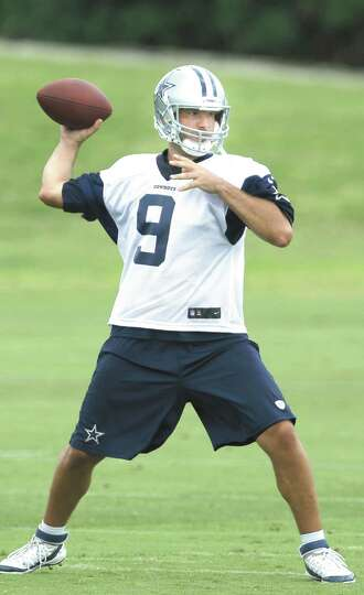 File- This June 18, 2014, file photo shows Dallas Cowboys quarterback Tony Romo passing during an NF