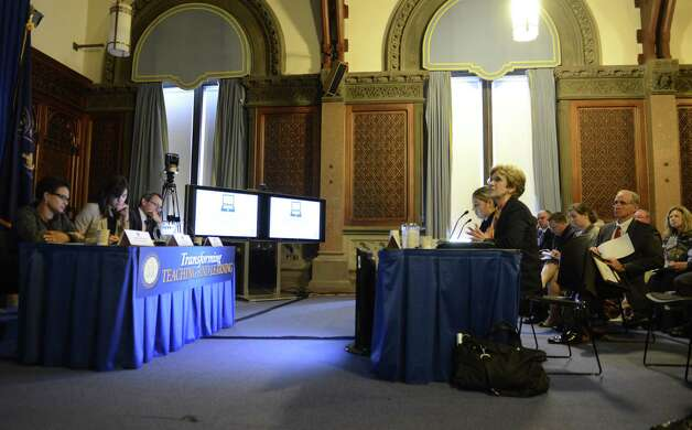 Ellen Meier, associate professor of computing and education at Columbia University, right, and Rita Sanchez, who joined Meier in her presentation, address panel members, left, during a Smart Schools Commission public symposium on how to enhance teaching and learning through technology Monday, July 21, 2014, at the Capitol in Albany, N.Y. The Smart Schools Commission is responsible for advising the State on how to best invest the proposed $2 billion Smart Schools Bond Act in order to enhance teaching and learning through technology. (Will Waldron/Times Union) Photo: WW / 00027855A